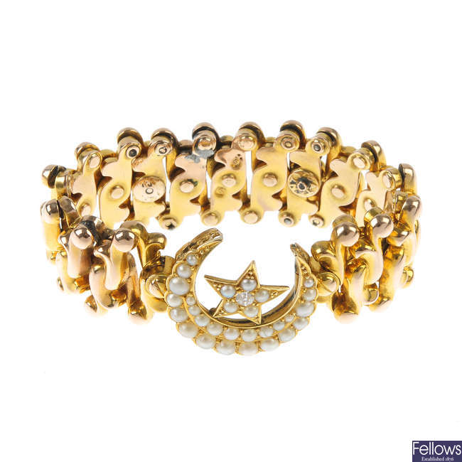 An early 20th century gold split pearl and diamond bracelet.