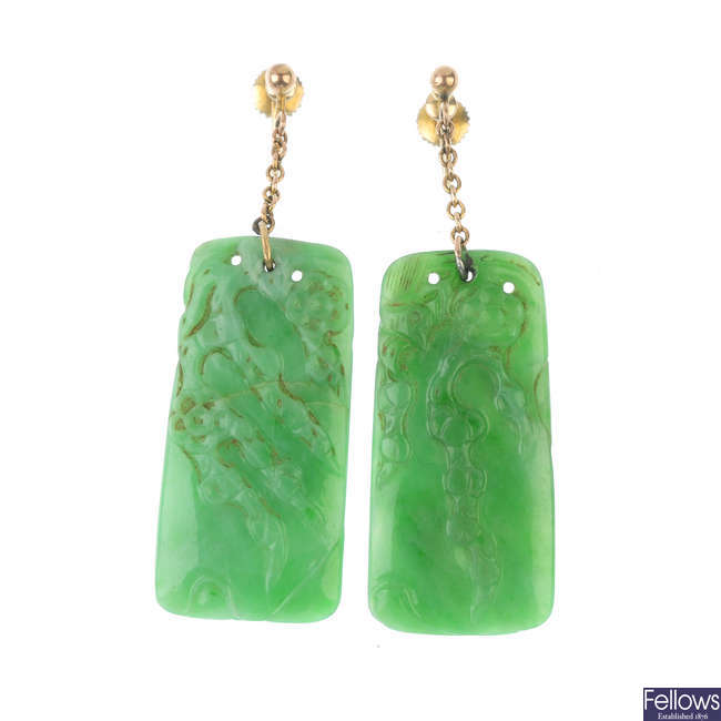 A pair of early 20th century jade ear pendants.