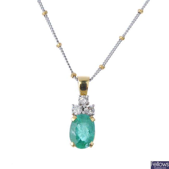 An 18ct gold emerald and diamond pendant, with chain.