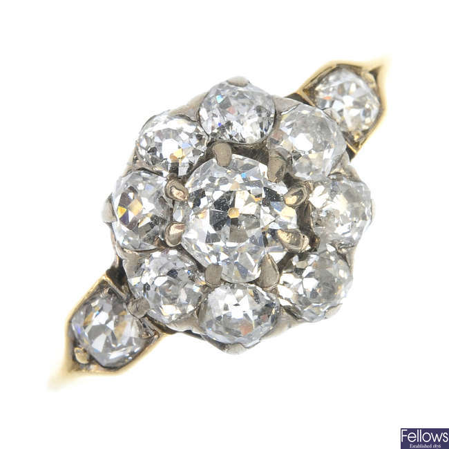 A mid 20th century gold diamond cluster ring.