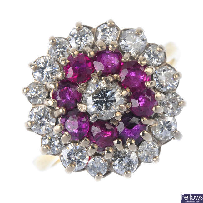 A 1970s 18ct gold ruby and diamond cluster ring.