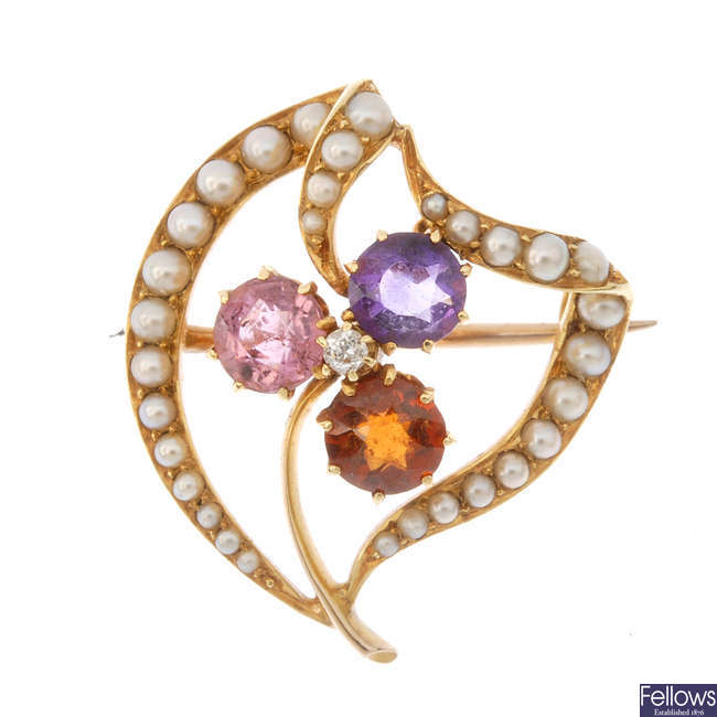 An early 20th century gold diamond, sapphire, amethyst and garnet brooch.