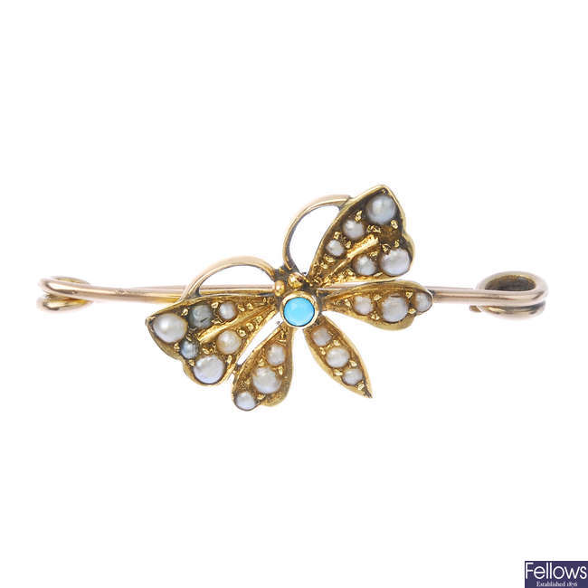 An early 20th century gold, turquoise and split pearl butterfly brooch.