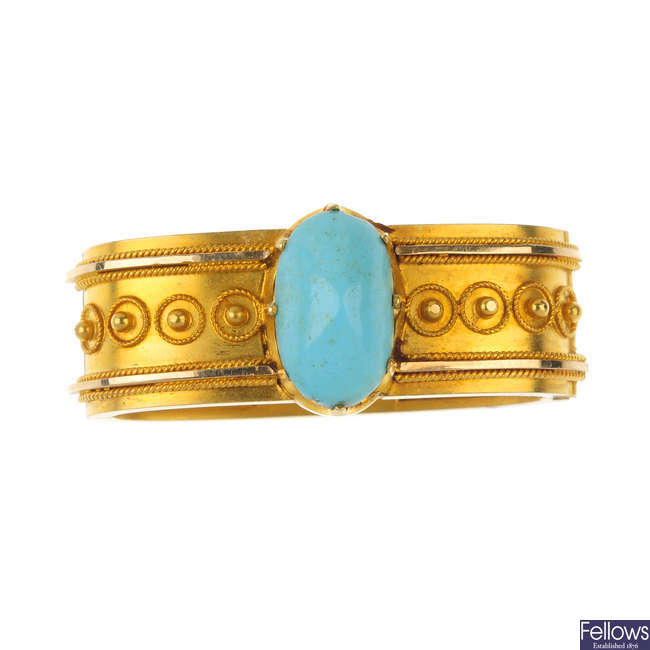 A late 19th century gold turquoise scarf clip.