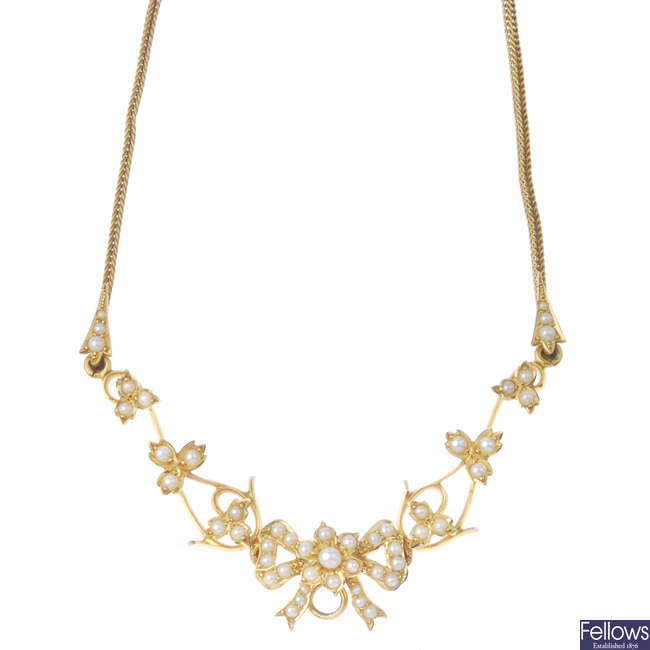 An early 20th century gold seed pearl floral necklace.