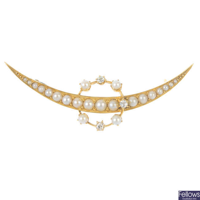 An early 20th century 18ct gold diamond and split pearl crescent brooch.