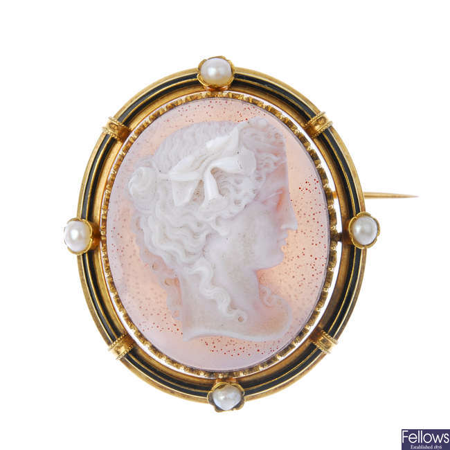 A late 19th century gold hardstone, split pearl and enamel cameo brooch.