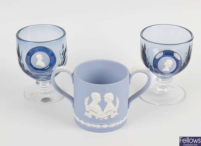 A box of assorted Wedgwood commemorative items