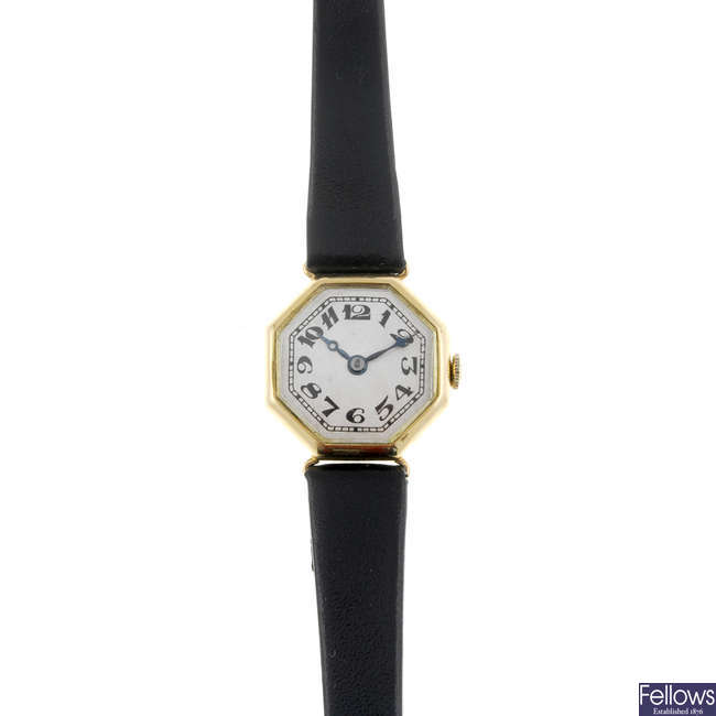 A lady's 18ct yellow gold wrist watch together with a silver watch head.