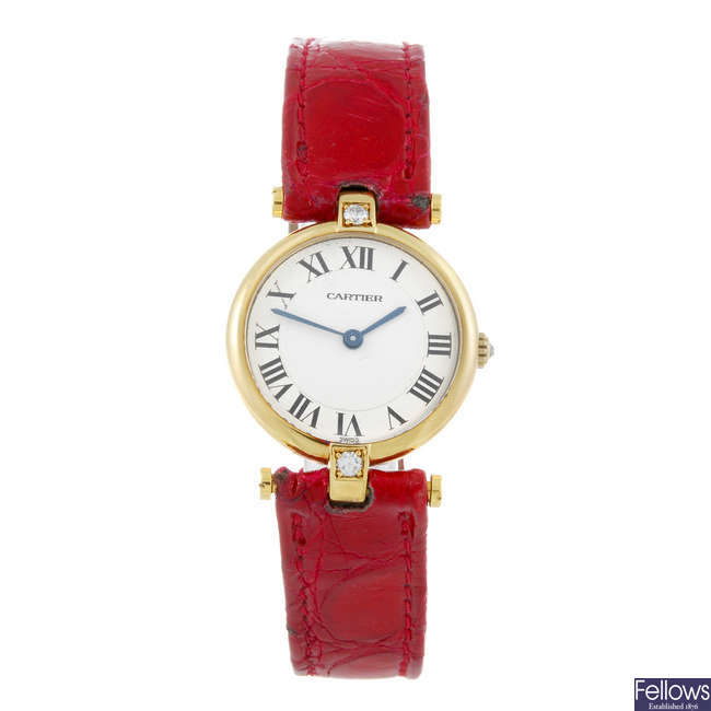 CARTIER - a factory diamond set yellow metal Vendome wrist watch.