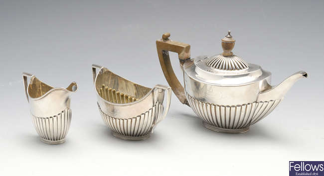 A late Victorian silver three piece bachelor tea set.