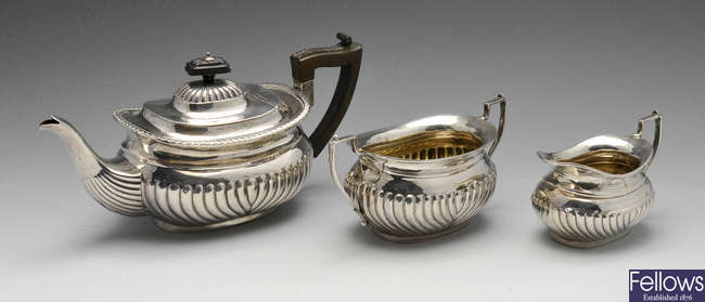 A matched three piece silver tea set.
