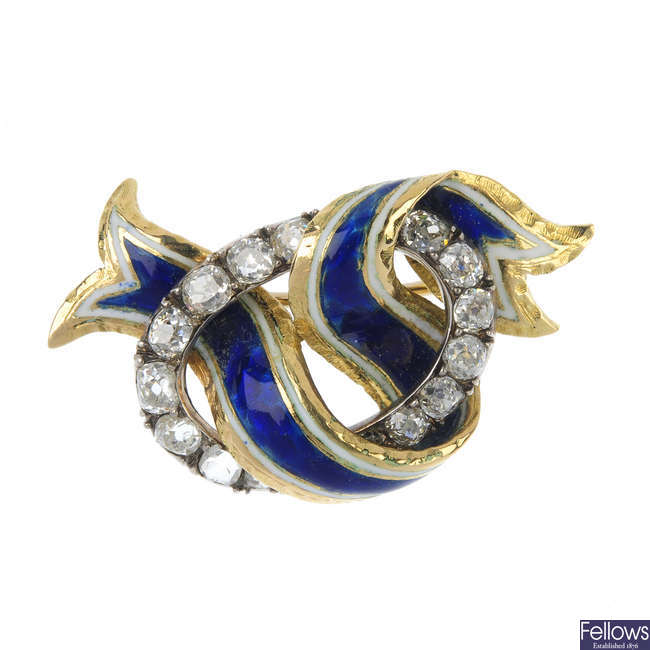 An enamel and diamond knot brooch.