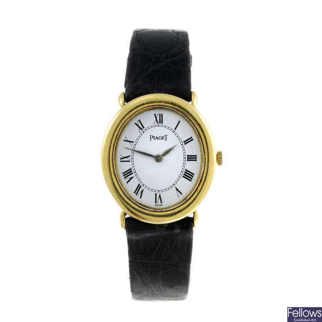 PIAGET - a lady's yellow metal wrist watch.