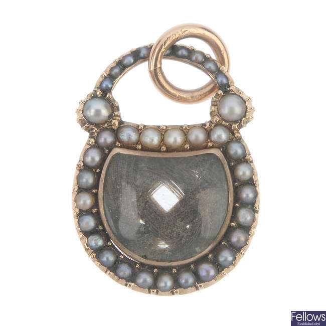 A mid 19th century gold split pearl mourning locket pendant.