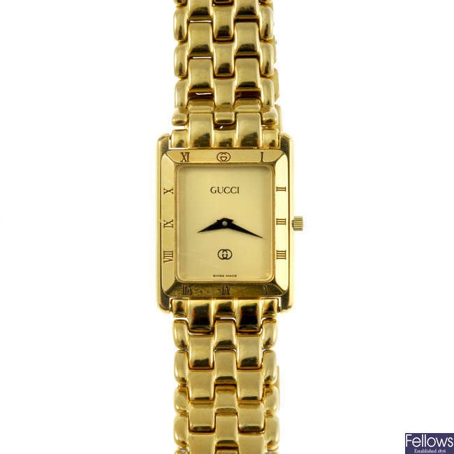 GUCCI - a gentleman's gold plated 4200M bracelet watch with a lady's Gucci 6000L wrist watch.