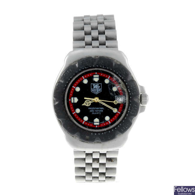 TAG HEUER - a mid-size stainless steel Formula 1 bracelet watch.