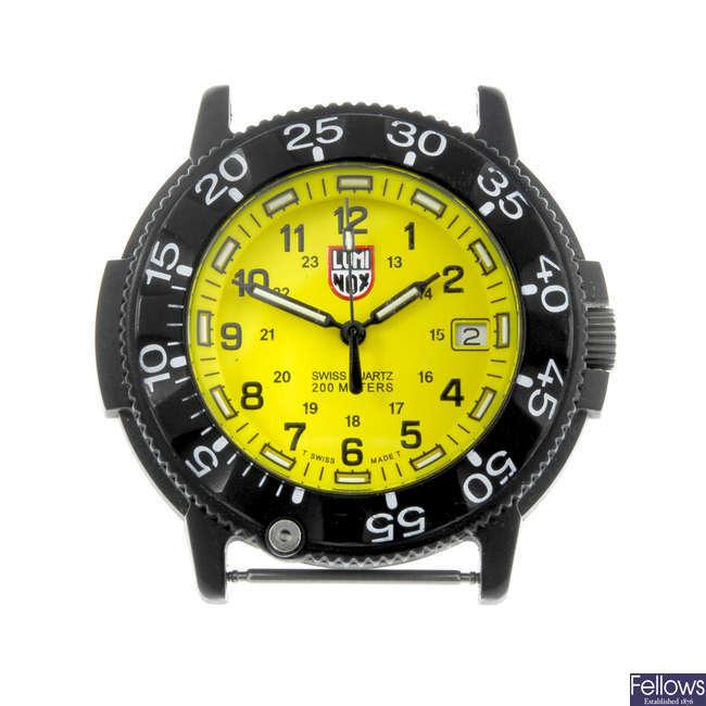 LUMINOX - a gentleman's bi-material Navy Seal watch head with two Citizen bracelet watches.