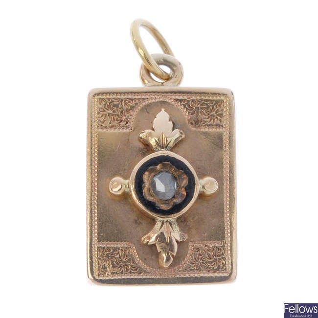 A late Victorian gold diamond and enamel memorial charm/pendant.