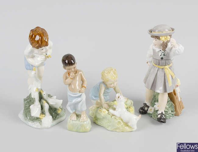 Four Royal Worcester bone china figures