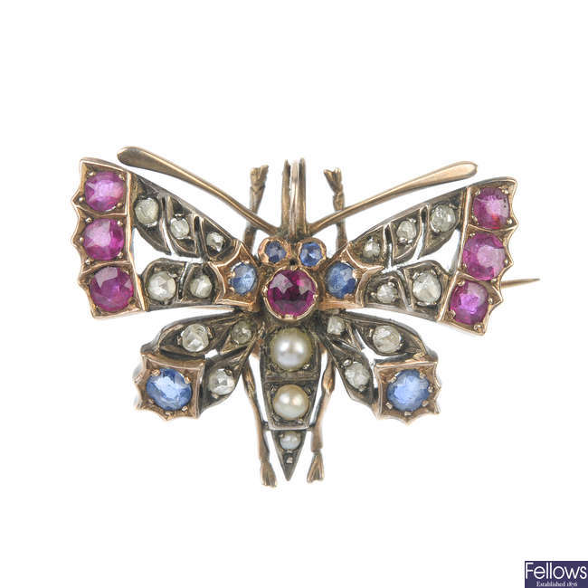 A late 19th century silver and gold diamond, ruby, sapphire and split pearl butterfly brooch.