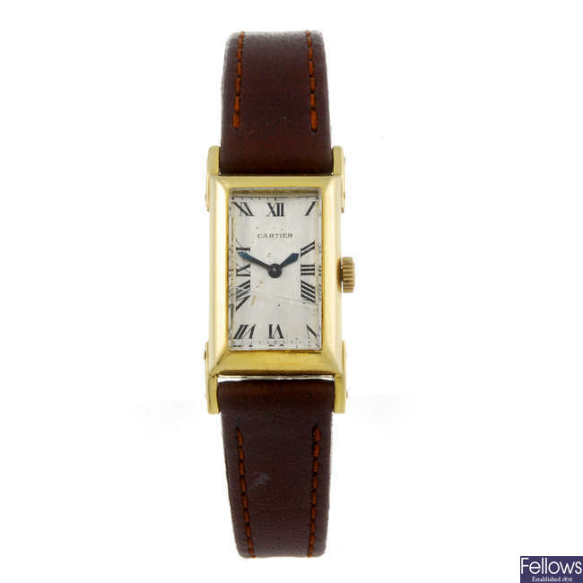 CARTIER - a yellow metal wrist watch.