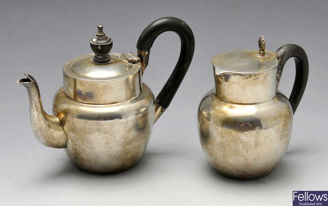 An Edwardian silver bachelor teapot and hot milk jug.