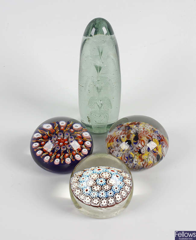 A group of four paperweights