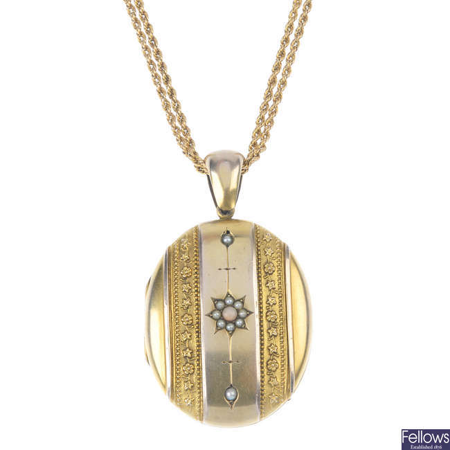 An early 20th century gold locket, with chain.