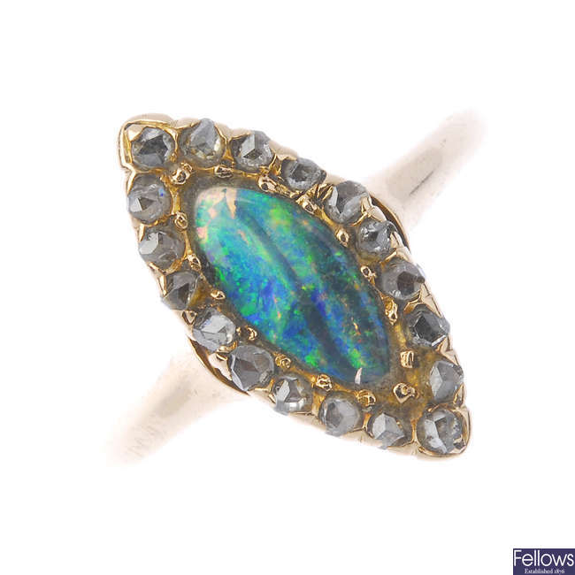 An early 20th century gold boulder opal and diamond cluster ring.