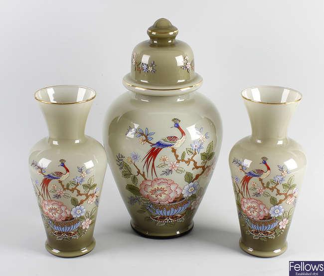 A garniture of three glass vases