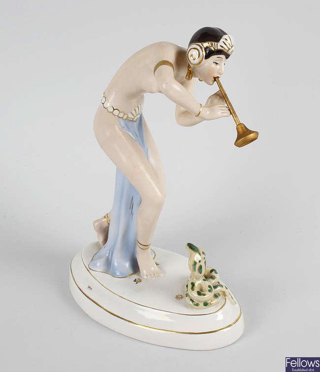 A Royal Dux figure.