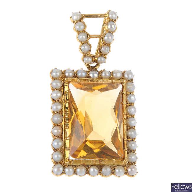 A split pearl and citrine pendant.