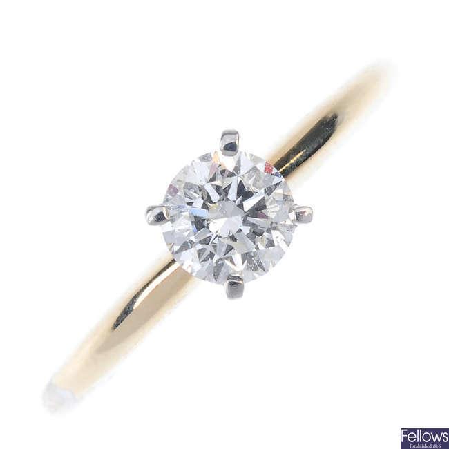 A diamond single-stone ring.