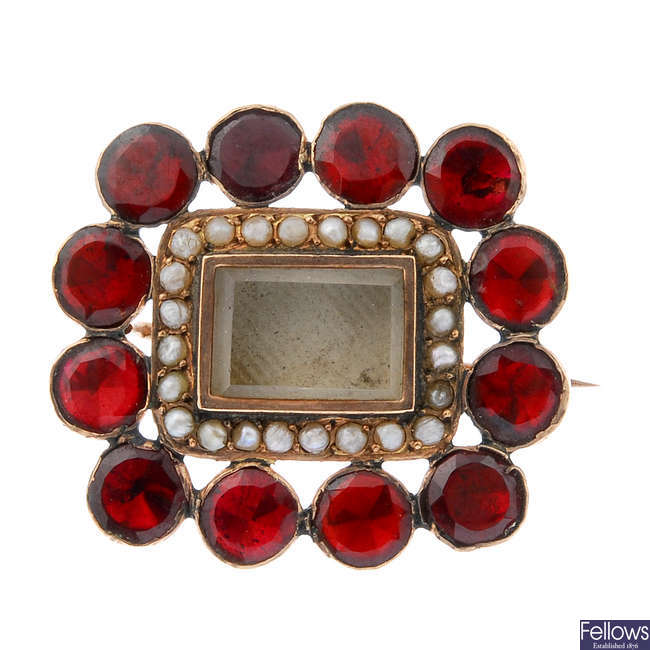 A garnet and split pearl mourning brooch.