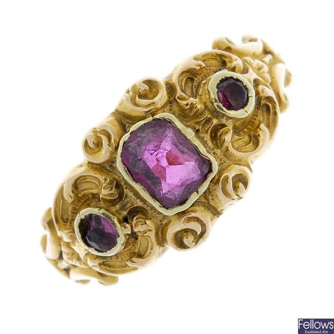 A late 19th century gold garnet three-stone ring.