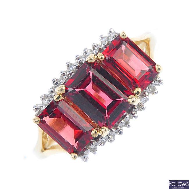 A 9ct gold garnet three-stone ring.