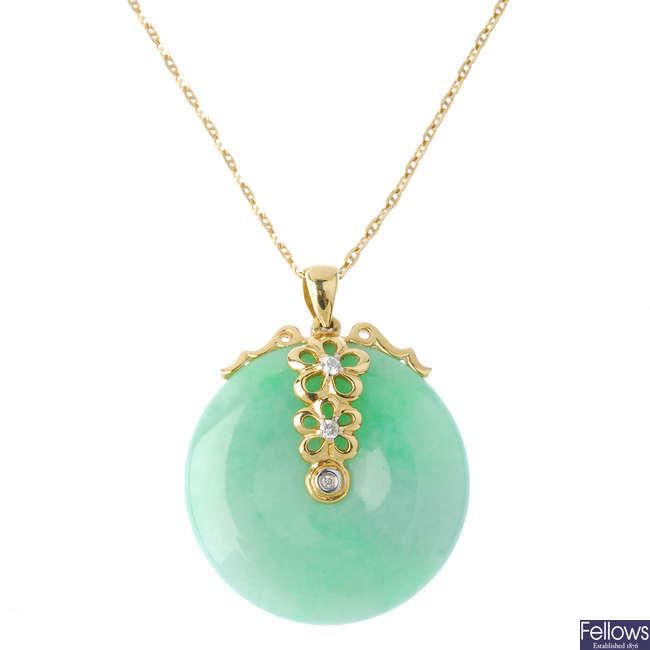 A jade and diamond pendant.