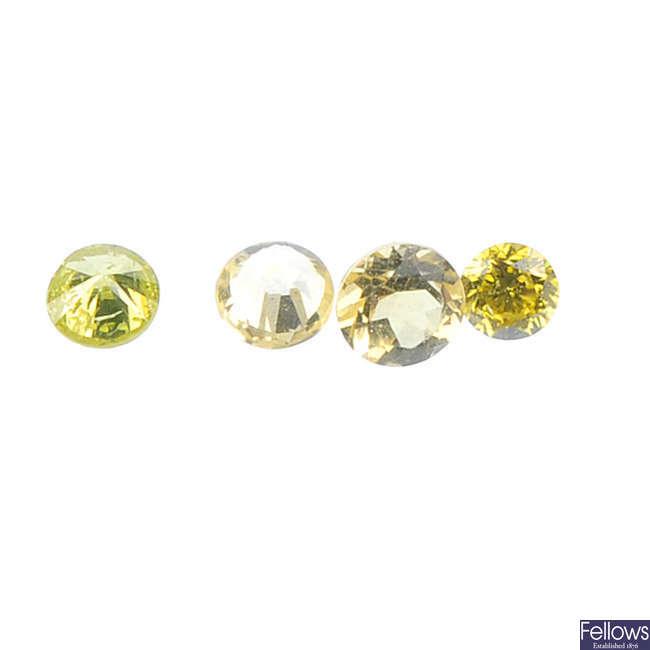 A selection of brilliant-cut colour treated diamonds.