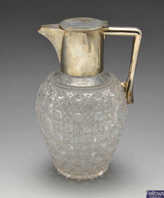 A late Victorian silver mounted glass claret jug.