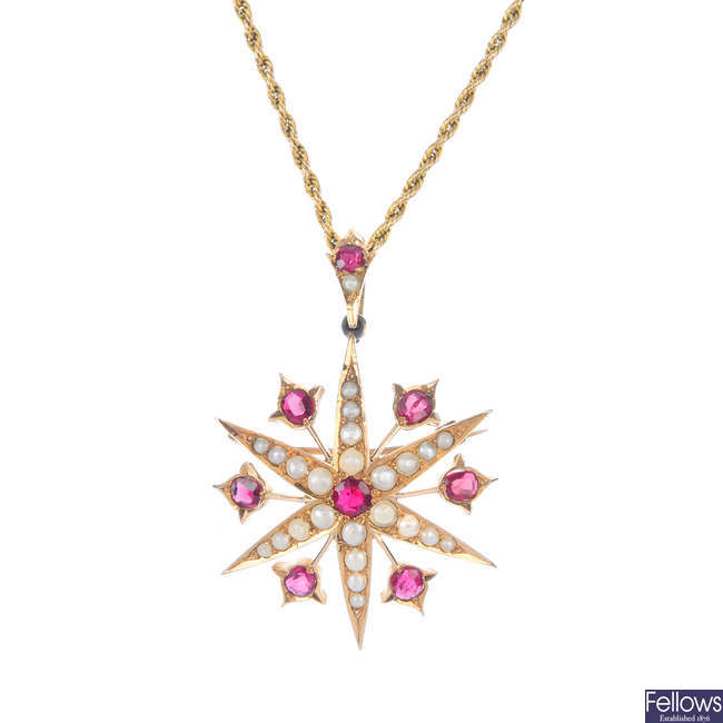 An early 20th century gold garnet and split pearl star pendant.