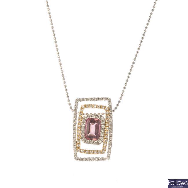 A tourmaline and diamond pendant.