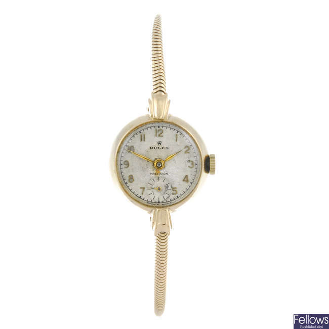 ROLEX - a lady's 9ct yellow gold Precision bracelet watch.