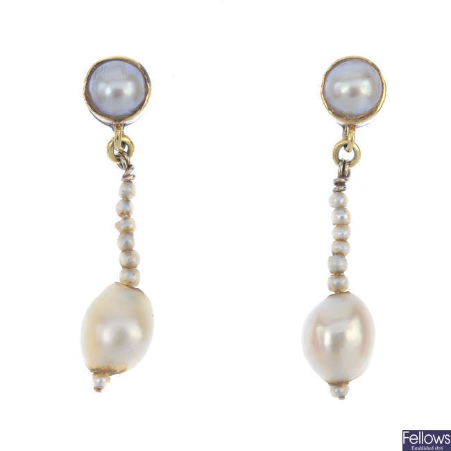 A pair of pearl ear pendants.