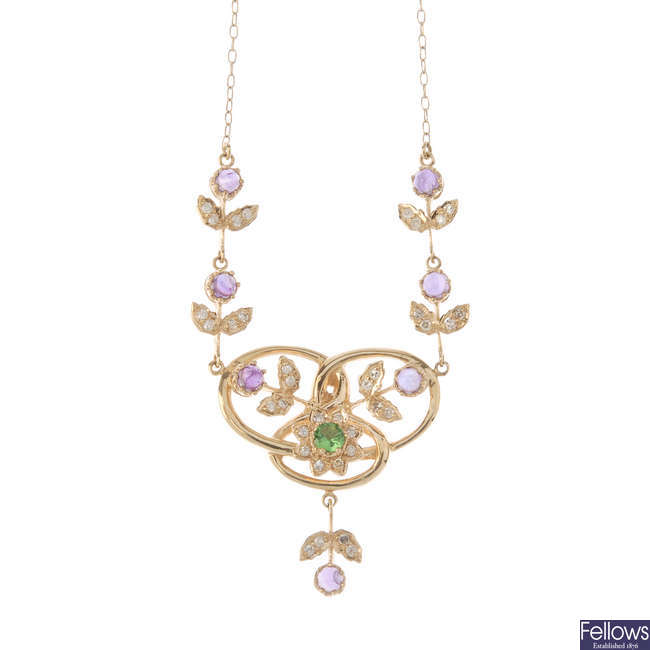 An amethyst, paste and diamond necklace.