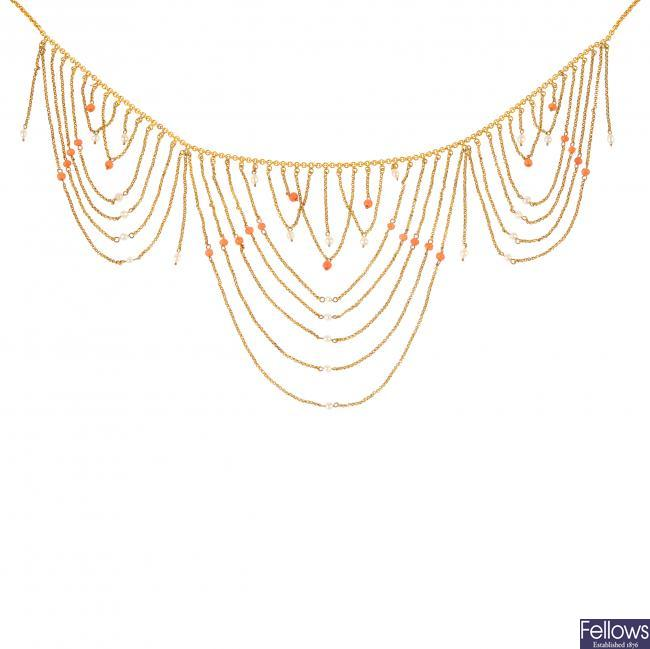 An early 20th century coral and seed pearl fringe necklace.