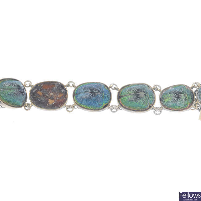 A scarab bracelet and brooch.