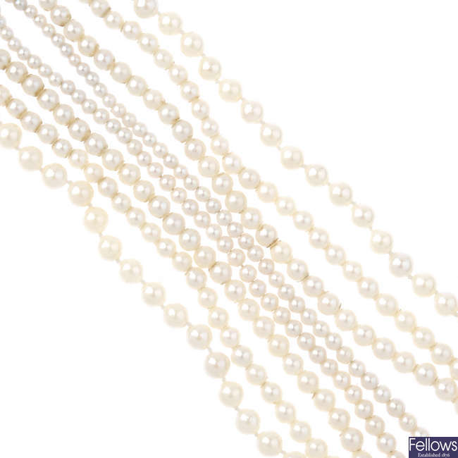 A selection of three cultured pearl necklaces.