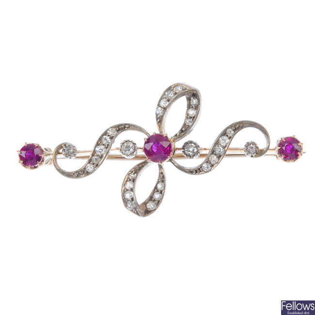 A late 19th century silver and gold ruby and diamond bow brooch.
