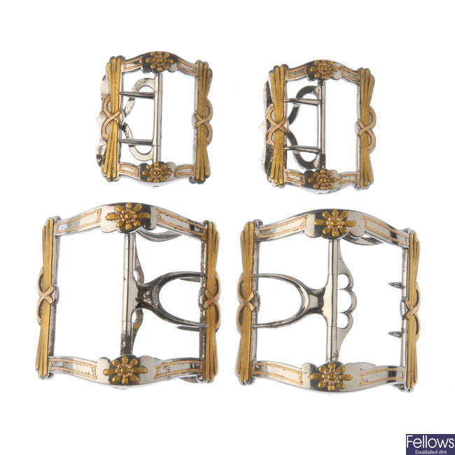 A cased set of four late Georgian buckles.